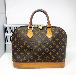 Louis Vuitton Alma Monogram top handle bag